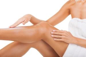 woman applying fake tan to her legs